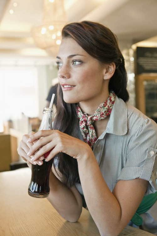 Woman drinking soda from bottle