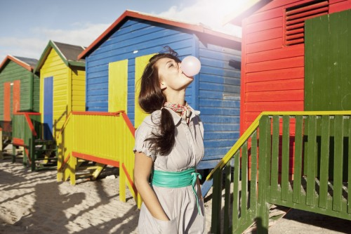Woman blowing bubble gum outdoors