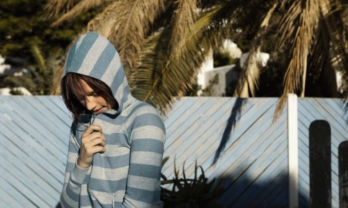 Young woman wearing a hoodie